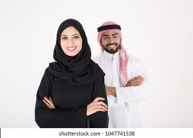 arab couple smiling and standing on white background