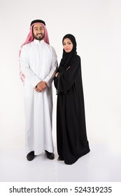 Arab couple standing on white background