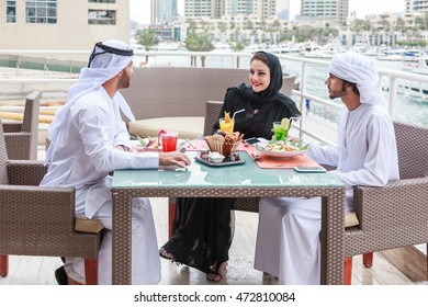Arab couple talking to each other after dining in Dubai UAE.