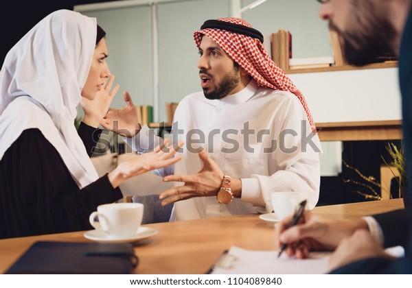 Arab couple at therapist reception quarrel. family quarrel. concept of psychotherapist