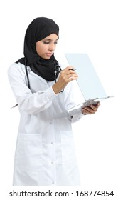 Arab doctor woman reading a clinical history isolated on a white background