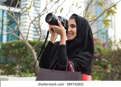 Arab Emirati Girl Taking Photos with a Photo Camera
