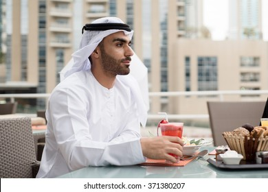 Arab Emirati Man Looking forward and Pointing Finger