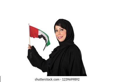 Arab Emirati woman celebrating UAE National day holding UAE Flags