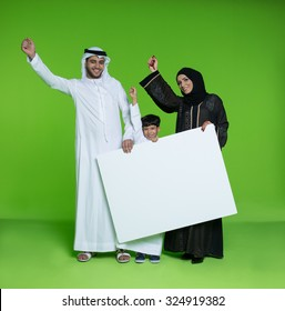 Arab family holding blank placard and cheering