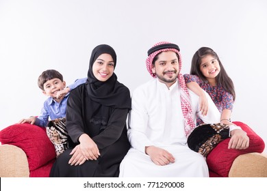 Arab family at home sitting on sofa with white background