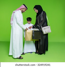Arab family looking into shopping bags