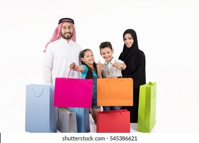 Arab family shopping on white background