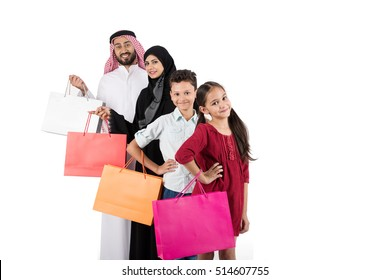 Arab family shopping and standing in raw