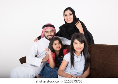 Arab Family sitting at home enjoying the time