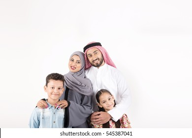 Arab family standing on white background