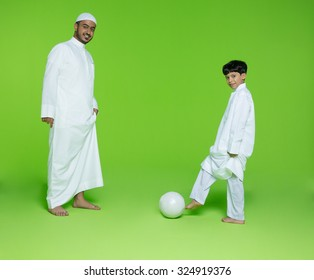 Arab father with son playing football