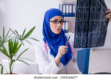 Arab female doctor working in the clinic