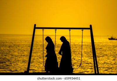 Arab girls evening walking silhouette , Jiddah Saudi Arabia