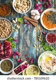 Arab ingredients for middle eastern food. Arabic cuisine ingredients. Background. Hummus, chickpea, lentils, rose buds, spices, pomegranate, pistachios. Halal food making. Space for text. Top view