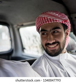 Arab male in car smiling