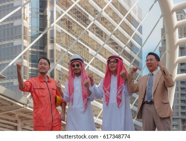 Arab male investors with partners and engineers are delighted at the sucsess.