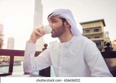 Arab man drink coffee in coffee shop in Dubai