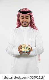 Arab man holding gift box