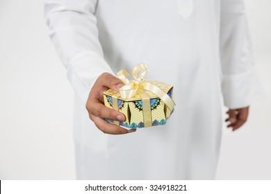 Arab man holding gift box