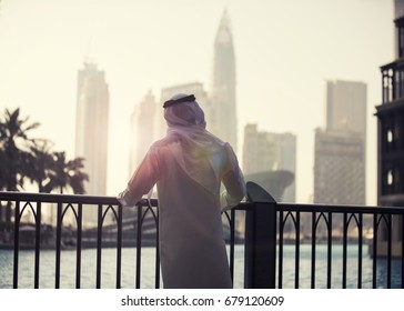 Arab man looking to Dubai skyline evening time