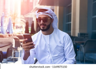 Arab Man outdoor using mobile