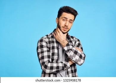 arab man in plaid shirt on a blue background islam