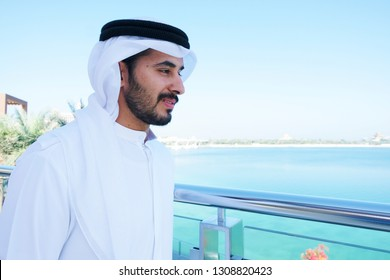 Arab man with positive face expression wearing thobe kandora - traditional cultural Middle East menswear