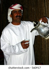 An arab man pouring the tea