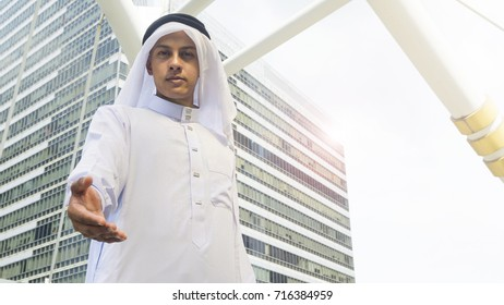 Arab man stands and take the hand up for welcome