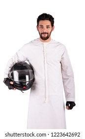 Arab man wearing kandora holding motorbike helmet in his arms,