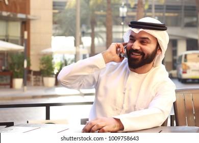 Arab man Wearing UAE Traditional Dress and Speaking In Phone