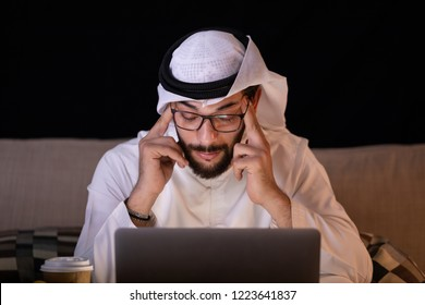 arab man working by night have a headache sickness.