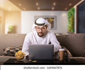 Arab man working from home sitting on sofa night time. coronavirus Quarantine. - Shutterstock ID 1694467876
