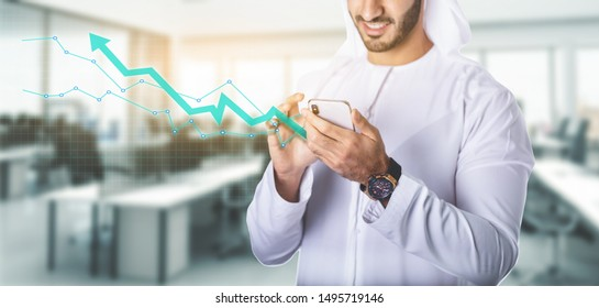 arab man working with smartphone in the office. business and finance concept.