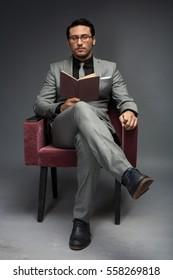 Arab men actor play in studio reading book professor teacher