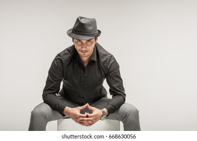 Arab men actor play in studio wears black hat ant shirt shows different characters and emotions