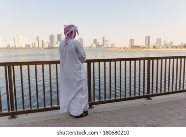 Arab men on the waterfront.