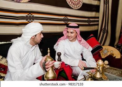 Arab men setting in traditional tent