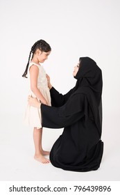 Arab mother with her daughter on white background