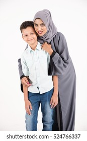 Arab mother with her son on white background