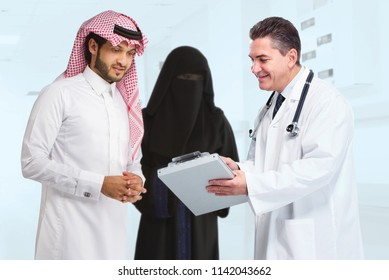 an Arab muslim couple with doctor in clinic hospital in Saudi Arabia middle east gulf