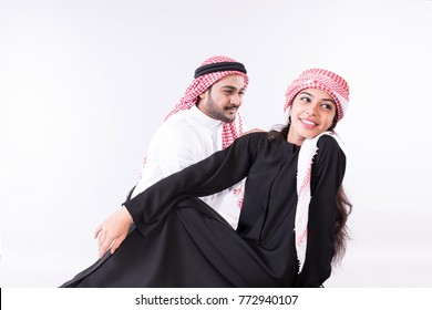 Arab muslim couple togother at home with white background
