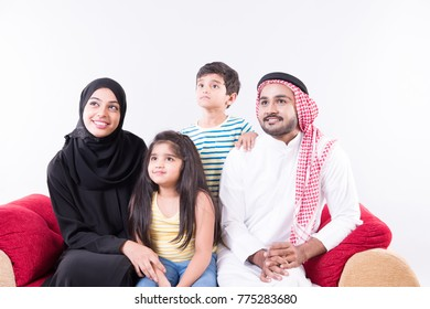 Arab muslim family spending time together at home with white background