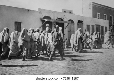 Arab prisoners of war walking in Tripoli, Libya, with Italian soldiers during the Italo-Turkish War. The Italian invasion of 100,000 soldiers was resisted by a small force of 20,000 Arabs and 8,000 Tu