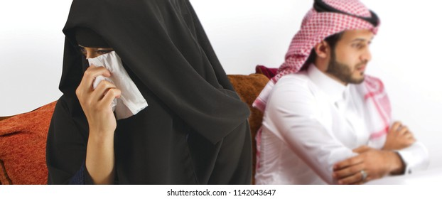 An Arab Saudi Couple sitting on couch unhappy wife crying in Saudi Arabia middle east gulf