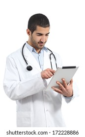 Arab Saudi doctor reading a tablet, isolated on a white background