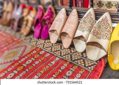 Arab slippers on a colorful carpet