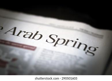 Arab Spring written newspaper, shallow dof, real newspaper.