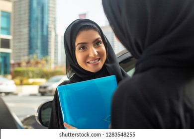 Arab student having a conversation with friend